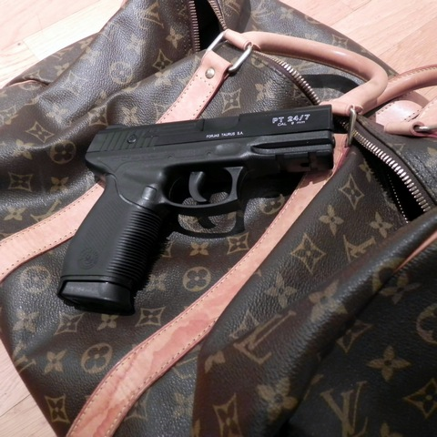 Louis Vuitton bag with gun